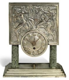 AN ART DECO MANTEL CLOCK CIRCA 1930                                                                                                                                                                                 More