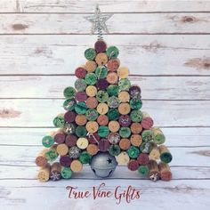 A handmade wine cork Christmas tree to help make your home festive for the holidays. Makes a perfect gift for the wine lover in your life. This delicate wine cork Christmas tree stands 12 inches and is 9 1/2 inches wide.