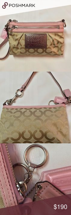 Coach Poppy Wristlet: Blushing Rose & Beige Coach Poppy Wristlet: Blushing Rose Fabric & Soft Leather w Coach's Beige High Quality Signature Fabric. Perfectly lined w a soft Medium Dusty Purple. One main zippered large compartment to hold wallet, makeup, etc. Plus a front zippered pocket to hold a small phone. Note: my iPhone 6s does not  fit in this bag.  Complete w key ring on the zipper (dress up w a purse Fob) & 2 yes 2 Coach Key Chains (One Dusty Rose Leather & One Clear Pink). Width…