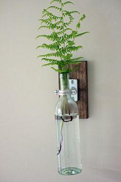 Items similar to Modern Bottle Sconce // Industrial Hanging Vase // Unique glass plant holder on Etsy Rustic Industrial, Modern Rustic, Bottle Chandelier, Hanging Vases, Vintage Bottles, Bottle Lights, Walnut Stain, Wine Bottle Crafts, Mason Jar Lamp