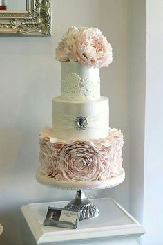 Lovely wedding cake with ruffled bottom tier, lace detail and brooch. ᘡղbᘡ