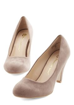 Minimalist Marvel Heel in Taupe. Many shoes have eye-catching patterns or flirty designs, but it's these basic, taupe pumps that are about to become your very favorite! #tan #wedding #modcloth