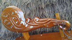 Patu on a stand Maori Patterns, Carving, Artwork, Work Of Art, Auguste Rodin Artwork, Wood Carvings, Sculpting, Artworks, Cut Work