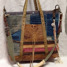 love the patchwork, denim, leather, worn, lived in look to this crossover handbag. #boho style #hippiechic70s