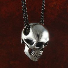 "Skull Necklace Antique Silver Anatomical Human Skull Pendant on 24"" Gunmetal Chain. $55.00, via Etsy."