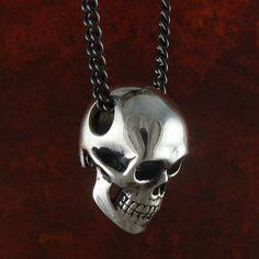"Skull Necklace Antique Silver Anatomical Human Skull Pendant on 24"" Gunmetal Chain. $55.00, via Etsy."