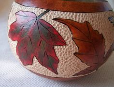 Wood burned and carved gourd bowl with ink dyed assorted variegated color leaves.1521.