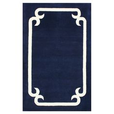 Wool-blend rug in navy with a contrast frame motif. Hand-tufted in India. Product: RugConstruction Material: N...