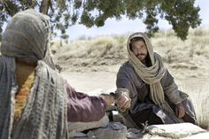 Christ reaching out to accept the well water offered to Him by the Samaritan woman.