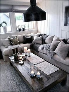 Like cozy couch and substantial, rustic-looking coffee table for TV room; though dont like light fixture here