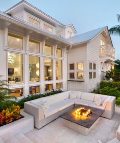 Wide window aspect looking onto outside social space with fire pit.  Gorgeous!
