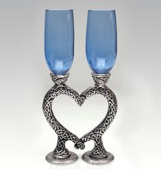 Light sapphire blue heart toasting glasses with Celtic knotwork stems. They form a heart at rest and are comfortable to hold when you separate them. Toasting Flutes, Champagne Flutes, Celtic Wedding Bands, Puzzle Ring, Rustic Wedding, Wedding Ideas, Celtic Heart, Lead Free