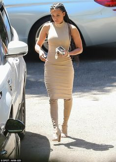 Stepping out: Mel B emerged for the first since since obtaining a restraining order agains...