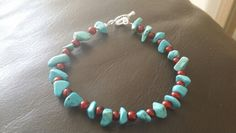 Turquoise chip pebble beads and red glass seed beads  £ 7.00