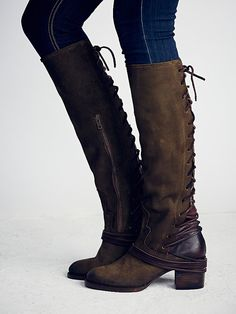 Coal Tall Boot | Washed leather tall boots, featuring tonal suede backs with leather lacing that wraps multiple times around the ankle and laces up to topline. Partial side zips and wooden block heels.   *By Freebird by Steven