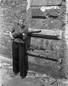 Warsaw Uprising. LOOKS LIKE ONE OF MY AUNTS HOLDING A GUN