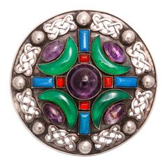 SYBIL DUNLOP Magnificent Rare Celtic Design Circular Brooch, set with amethyst, chrysoprase, and carnelian. Scotland, ca. 1900.