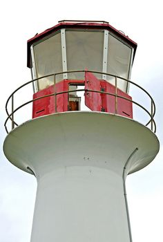 Point Aconi Lighthouse, Nova Scotia, Canada.  Located on Point Aconi, just east of the Great Bras d'Or Channel. Latitude: 46.336028; Longitude: -60.292417.  The circular figreglass tower & nearby buildings were destroyed in a suspicious fire in Feb 2014.