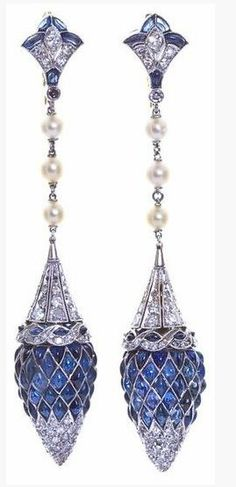 Treillage, Art Deco Diamond Sapphire Dangle Earrings. France. Dangling diamond and sapphire inlaid platinum earrings with pearl strands. Deco styled diamond and sapphire fleur-de-lis top connects to a gorgeous diamond and platinum conical cap edged with diamond swirl border with a pointed acorn shape formed from sixty marquise and pear shaped cabochon cut sapphires tipped with a delicate diamond melee point swiveling beneath.