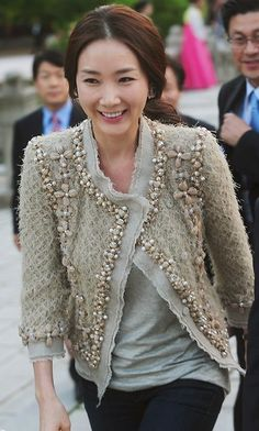 Chanel tweed jacket.. Bead detailing: