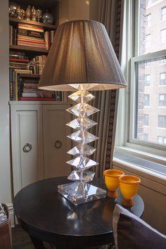 A crystal desk lamp in the corner of a living room. Interior Design: Robert Passal