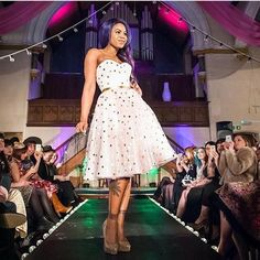 A beautiful photo of the Dresses in action on the Catwalk. Make up by Benefit.
