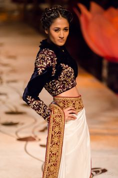 Rohit Bal. The jacket blous isn't very nice but I like the idea of a plain white Saree with that border