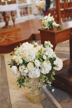 All in white flowers for our Canadian couple. Beautiful church with Caravaggio's fresco right in the center of Rome. www.weddingsinrome.com