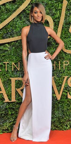 Jourdan Dunn in a black-and-white dress with a thigh-high slit