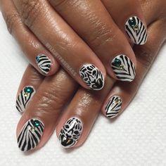 "fleuryrosenails: ""A little @lanvinofficial inspired #nailart using @flossgloss #1080pearl #blackholy ❄️❄️❄️❄️❄️ #handpainted #whitetiger #tiger #shimmer #lanvin """