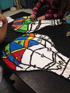 """My Second graders have been working on these Hot Air Balloons now for a few weeks! I have laid down the law with my expectations of coloring with """"No white showing""""    Thus not a rapid breeze through project!"""