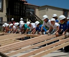 Volunteer for Habitat for Humanity or another charity of my choice