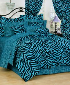 Karin Maki Black and Blue Zebra Stripe Bedding is the perfect teenage girl bedding on solid bright blue with accenting black zebra stripe patterns.