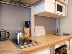 Kitchen Furnished Apartments, Rental Apartments, London Apartment, Holiday Apartments, One Bedroom, Museums, Kitchen Cabinets, Home Decor, Restaining Kitchen Cabinets
