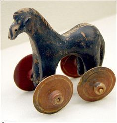 Toy horse, Greek, dated around 10BC.  Ancient Greek children had an assortment of toys to choose from, such as dolls, marbles, dice, and the yo-yo. Gender stereotypes, social interaction and role play could be reinforced through play. Monkeys, birds, dogs and cheetahs were also kept as pets.  The children normally spent their early childhood in the women's quarters, and at the age of around 7, boys started going to school whilst the girls stayed at home to learn the women's duties.