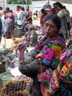 Mayan women don their hand loomed textiles at the market in Chichicastenango