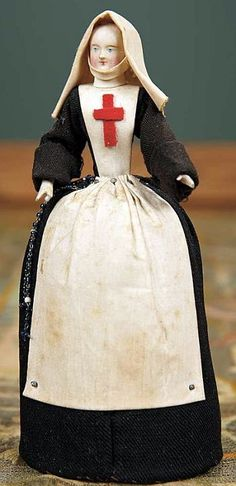 Early French Paper Mache Doll in Nursing Costume as a Pincushion.
