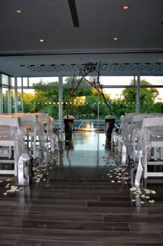 The Clayton on the Park can provide a lovely setting for a wedding ceremony. White wedding chairs included with ceremony space rental