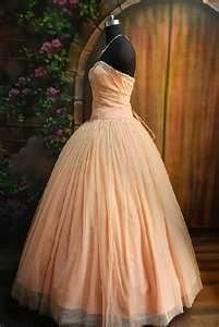Love the peach colored dress!!