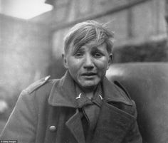 A fifteen year old German soldier, Hans-Georg Henke, cries being captured by the US 9th Army in Germany on April 3, 1945.