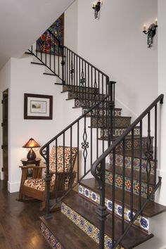 The decorative tiles on the stairway makes traveling from one floor to the next delightful. Love this idea!