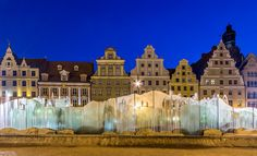 Fountain and tenement houses in the evening/ Wrocław, Poland