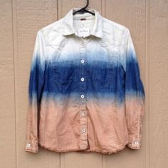 ❤️V Day Sale❤️Free People Denim Shirt 100% authentic Free People denim shirt. This is such a cool twist on the average denim or chambray shirt. It features a beautiful ombré dip dye from white, to blue, to dusty orange. It has a very desert bohemian vibe. Gorgeous coloring. Oversized fit, will also work for size S. Brand new without tags. Bundle & save.  Free People Tops Button Down Shirts