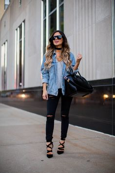 fashion blogger mia mia mine in an oversized jacket and black denim jeans by…