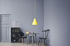 The Treetop pendant has a lacquered metal shade and a solid oak top. It is the…