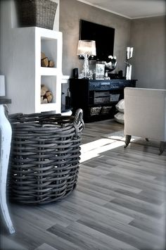 the grey neutral tones with the white and black and brown. especially love the floor.