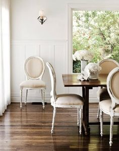 Dinning Room: bright white walls, cream colored chairs, dining room table stained to match the color of stain on the floor {my dining room inspiration} Dining Room Inspiration, Interior Design Inspiration, Color Inspiration, Design Ideas, Dining Room Design, Dining Room Chairs, Dining Rooms, Sunroom Dining, Wood Chairs