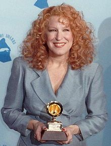 Bette Midler (born December 1, 1945) is an American singer, actress, and comedian, also known by her informal stage name, The Divine Miss M. She became famous as a cabaret and concert headliner, and went on to star in successful and acclaimed films such as The Rose, Ruthless People, Beaches, and For The Boys