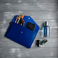Did not know how to use this clutch? Here is one more idea for you :) #leatherclutch #blueleather #envelopeclutch #wristletclutch #leatheraccessories #leatherclutchbag #minimalistclutch #leatherwristlet #bridesmaidclutch #leathertoiletrybag #toiletrybag # Crazy Horse, Travelers Notebook, Leather Folder, First Home Gifts, Leather Clutch Bags, Red Clutch, Leather Wallets, Bridesmaid Clutches, Minimalist Bag