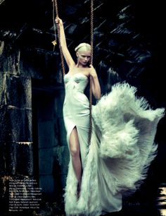 Abbey Lee Kershaw in Versace Autumn/Winter 2011-2012 ostrich feather and crepe silk gon for Charles Varenne's Madone editorial published in Numéro #126.